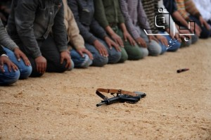 Libyan rebel fighters pray before headin - Afp Photo Getty Images - Roberto Schmidt